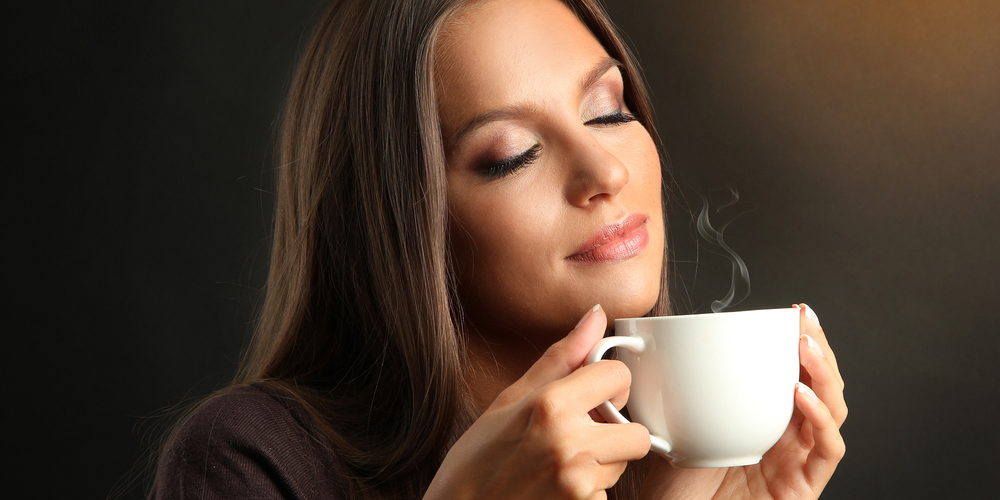 Woman with holding a cup of coffee