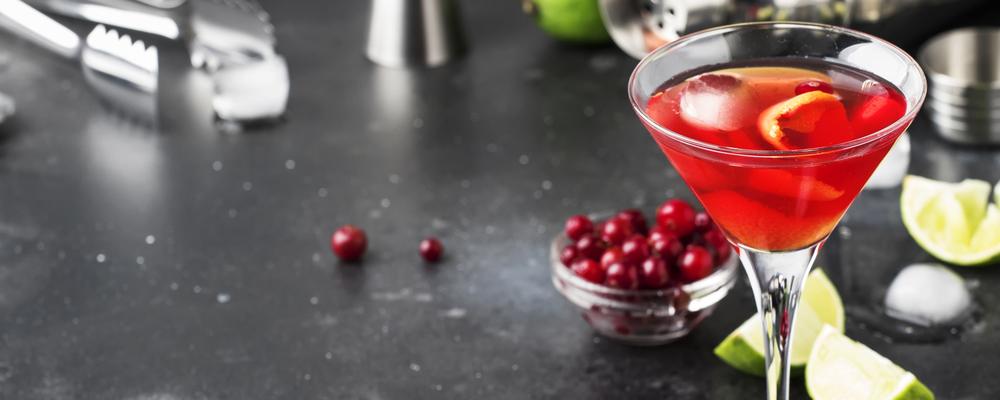 Classic alcoholic cocktail cosmopolitan with vodka, liqueur, cra
