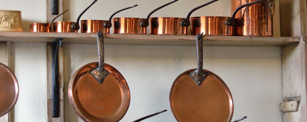Row of copper pots