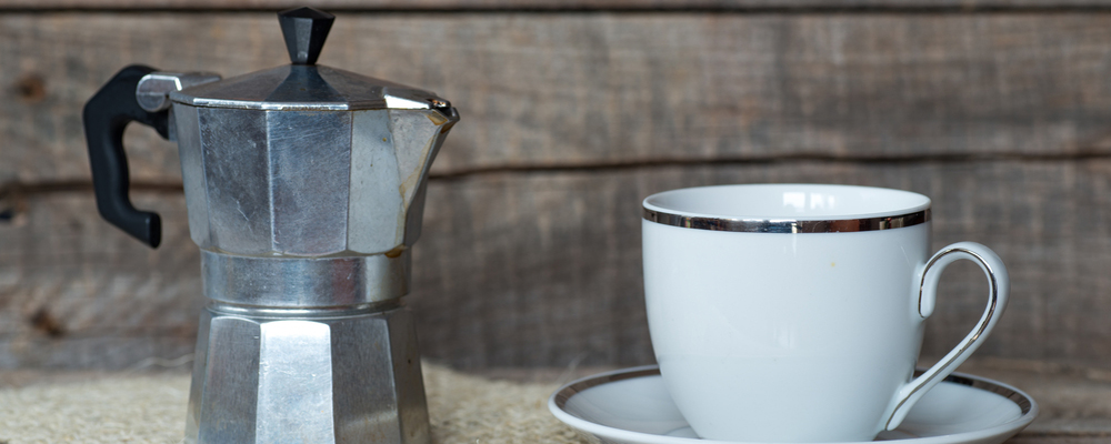 Cup of coffee and coffe maker