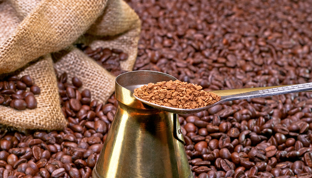 Instant coffee spoon with sack and coffee background