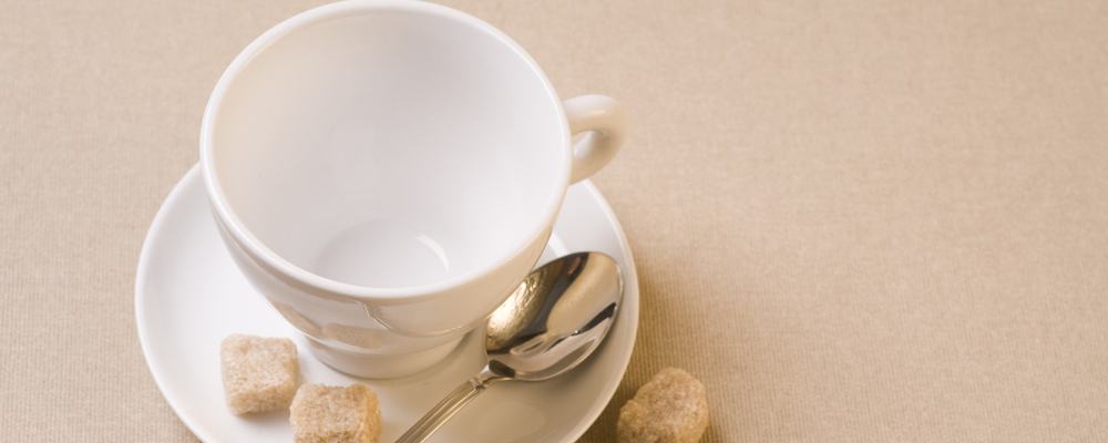 White empty coffee cup with brown sugar