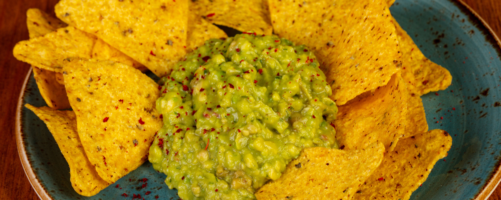Nachos chips with guacamole sauce