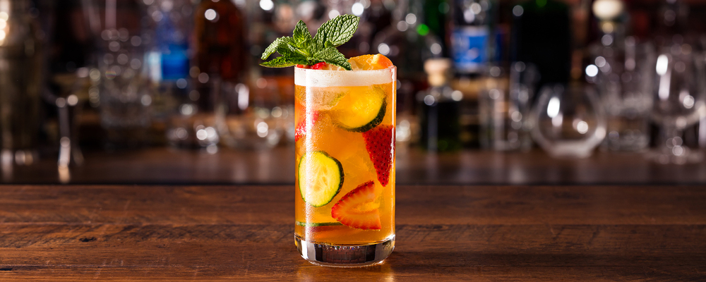 Refreshing Pimms Cup Cocktail on a Bar