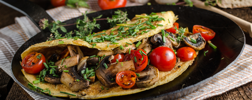 Rustic omelette with mushrooms and tomatoes
