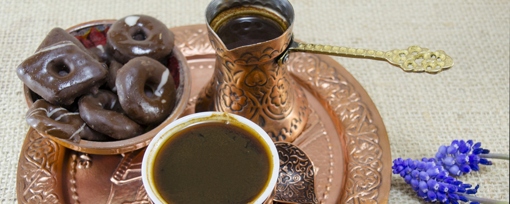 Turkish coffee with cookies and flowers