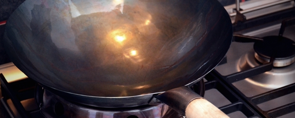 Wok on the heating stove
