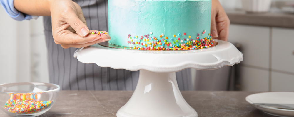 Woman decorating birthday cake