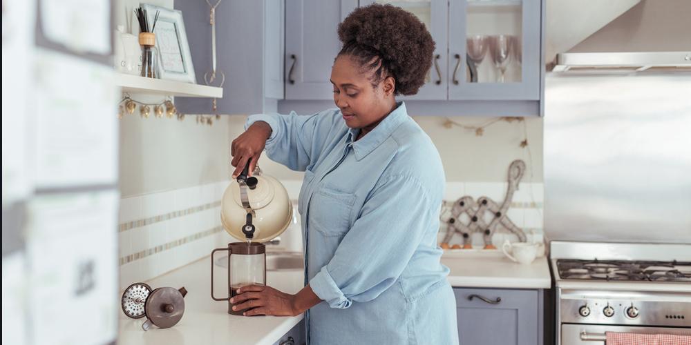 Woman preparing fresh coffee