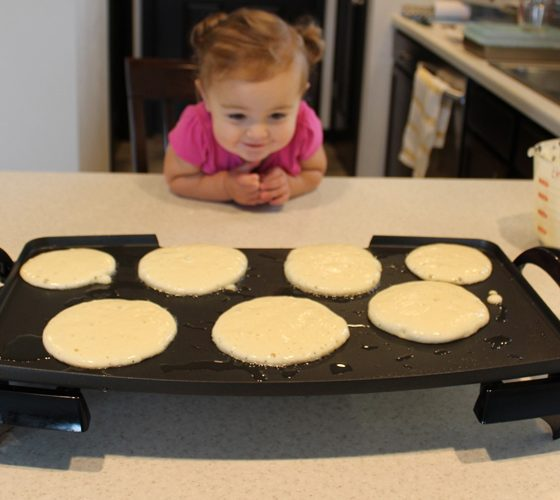 Child waiting for pancakes