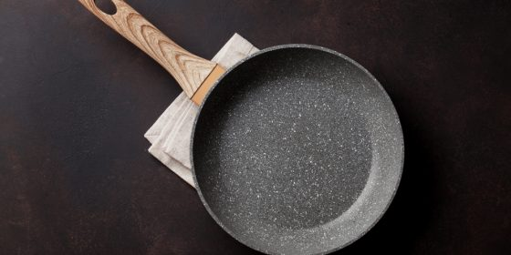 Frying pan over stone table