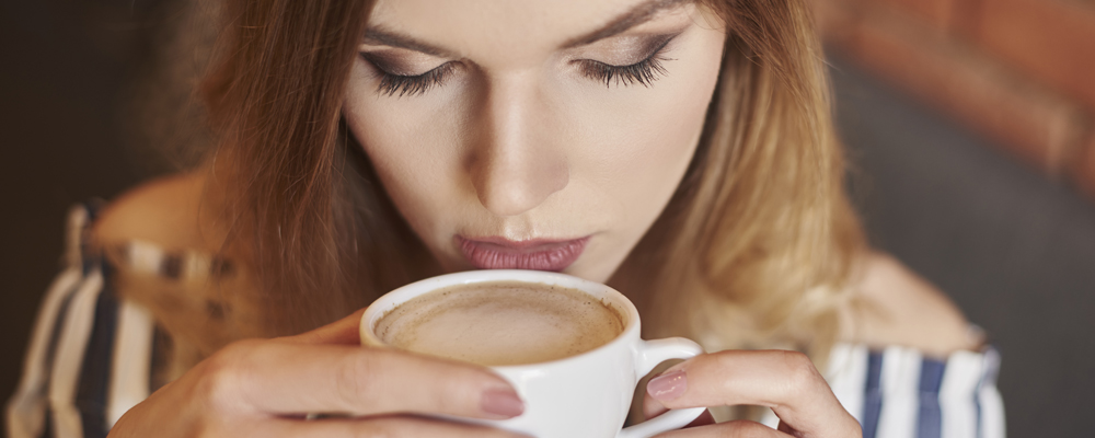 Headshot of woman drinking coffee