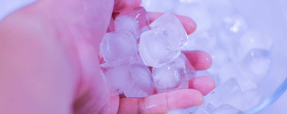 Ice cubes on person's hand