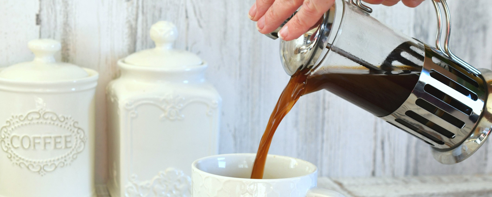 Pouring coffee from a French press coffee maker