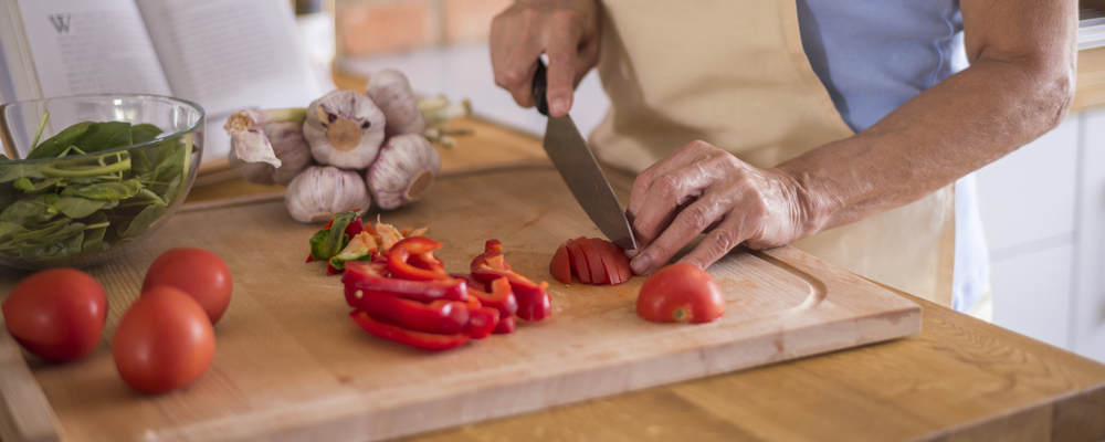 Vegetables being cutted on the cutting board