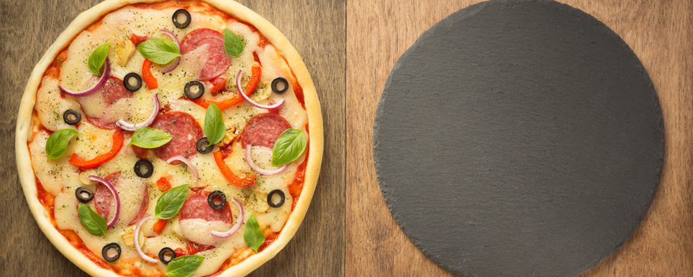 pizza and food ingredients at wooden table, top view