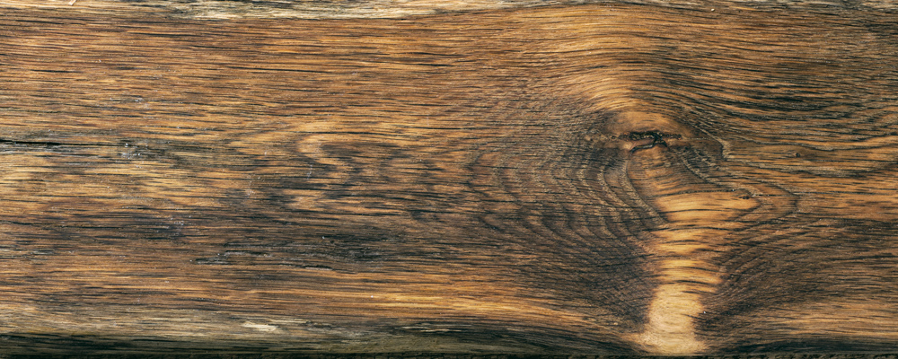 wooden cutting board on rustic table, top view