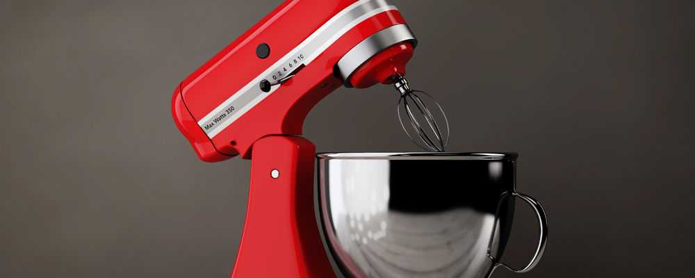 Red Kitchen Stand Food Mixer on a wooden table. 3d Rendering